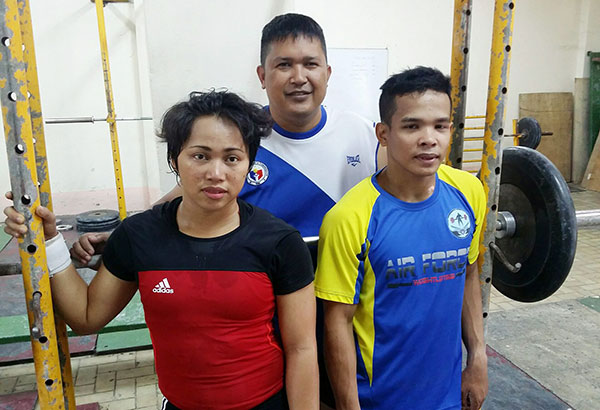 Olympic weightlifters Hidilyn Diaz and Nestor Colonia with coach Dondon Aldanete.