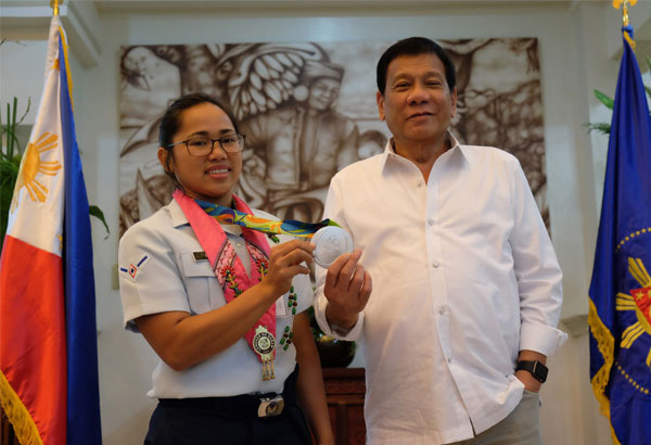 Olympic silver medalist Hidilyn Diaz poses with President Duterte during a courtesy call in Davao City on Thursday night. | Ace Morandante/PPD