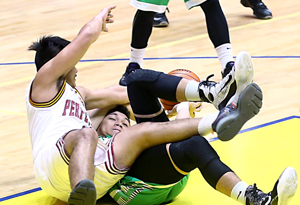 Jack Jao of Perpetual Help and Christian Fajarito of Saint Benilde hit the floor as they get tangled fighting for possession during their match in the NCAA Season 92 at the San Juan Arena. JOEY MENDOZA