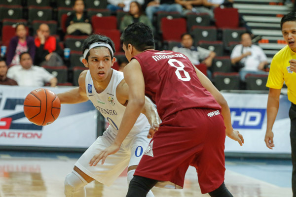 Thirdy Ravena of Ateneo is being guarded by UP's Dave Moralde.   Efigenio Toldeo IV/Philstar.com