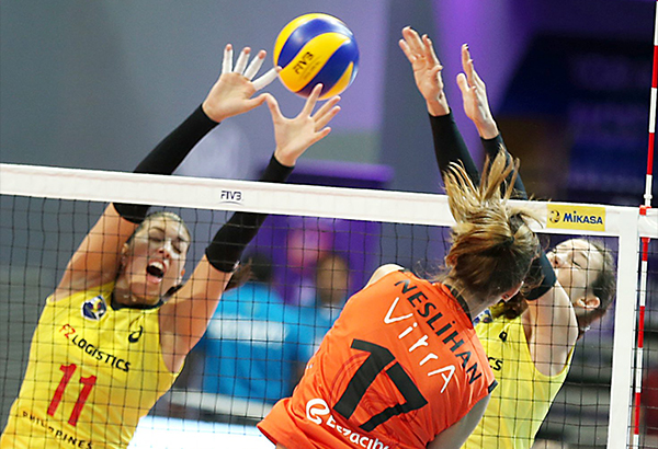 Nieslihan Demir (17) of Eczacibasi VitrA Istanbul bangs in a kill against PSL-F2 Logistics Manila imports Lynda Morales (11) and Stephanie Niemer during their FIVB Women's Club World Championship pool match at the MOA Arena. JOEY MENDOZA JR.