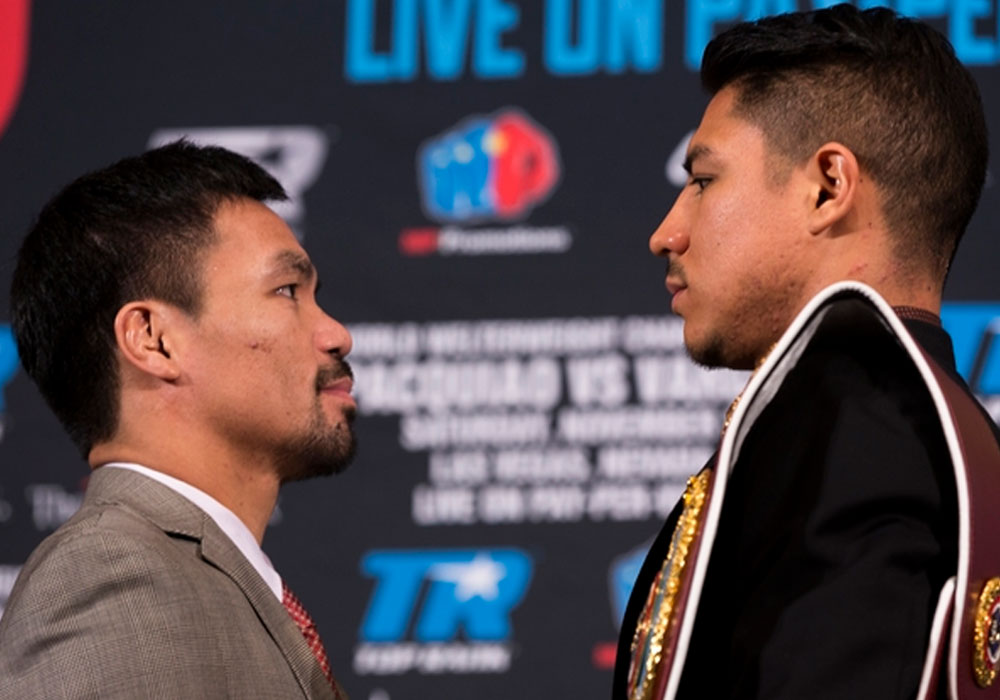 Manny Pacquiao, left, and Jessie Vargas face each other during a news conference in Beverly Hills, Calif., on Thursday, Sept. 8, 2016., about their WBO welterweight title fight scheduled for November 5. | AP Photo/Damian Dovarganes