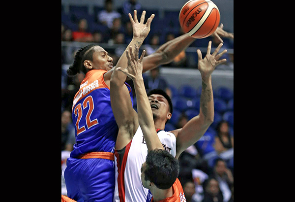 Matt Ganuelas Rosser of Talk N Text taps the ball away from Reil Cervantes of Blackwater while Larry Fonacier (right) and a teammate (hidden) provide support in yesterday's PBA Philippine Cup at the Smart Araneta Coliseum. JOEY MENDOZA JR.