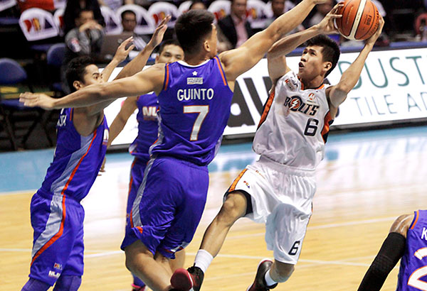Meralco Bolt Ed Daquioag shoots against Bradwyn Guinto of the NLEX Road Warriors at the Smart Araneta Coliseum. PBA Media Bureau