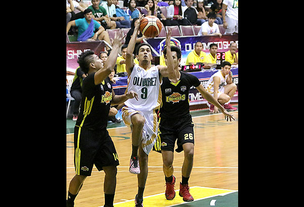 Olivarez College's Albert Rabe drives to the basket against TIP's Harley Diego and Bryan Santos during their do-or-die match in the UCBL yesterday at the Olivarez Sports Center, Parañaque.