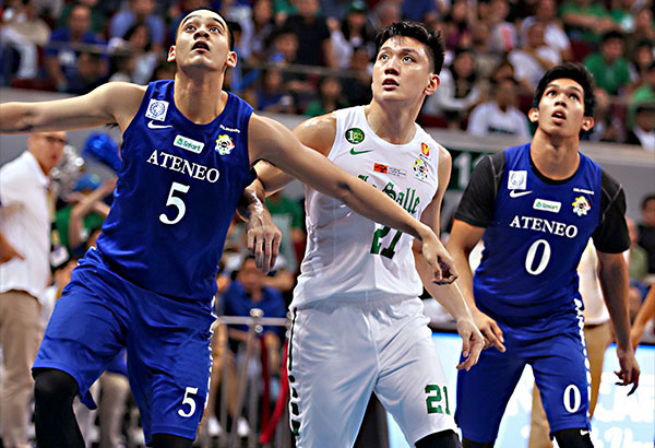 Blue Eagles Manuel Tolentino and Thirdy Ravena of Ateneo brace for a rebound with Green Archer Jeron Teng. JOEY MENDOZA JR.