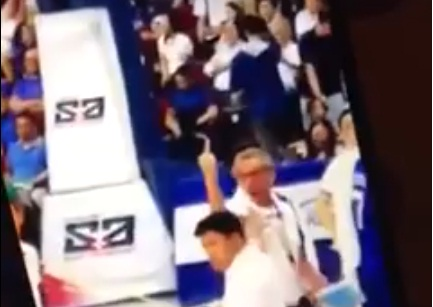 Screen grab from the video posted online where Ateneo's assistant coach Gabby Severino was flashing his middle finger.