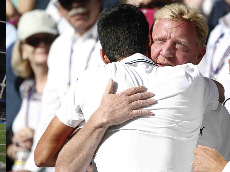 """In this July 6, 2014, photo, Novak Djokovic, of Serbia, celebrates with his coach Boris Becker, right, in the players box after defeating Roger Federer of Switzerland in the men's singles final at the All England Lawn Tennis Championships in Wimbledon, London. Djokovic says he and coach Boris Becker are splitting up after three seasons together. Djokovic posted a statement on Facebook on Tuesday, Dec. 6, 2016, saying the duo """"jointly decided to end our cooperation."""" 