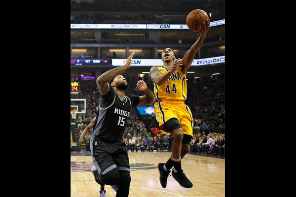 Indiana Pacers guard Jeff Teague, right, goes to the basket against Sacramento Kings center DeMarcus Cousins during the first half of an NBA basketball game Wednesday, Jan. 18, 2017, in Sacramento, Calif. |AP Photo/Rich Pedroncelli
