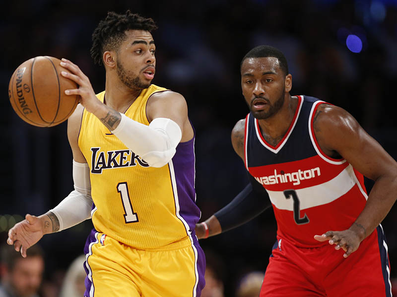 Los Angeles Lakers guard D'Angelo Russell controls the ball while Washington Wizards guard John Wall, right, defends him during an NBA game, Tuesday, March 28, 2017, in Los Angeles (Wednesday in Manila). | AP Photo/Danny Moloshok
