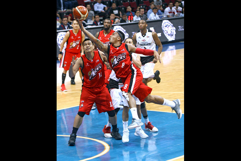 Alaska Aces' Calvin Abueva finger-rolls one in during their match against the Mahindra Floodbuster in the PBA Commissioner's Cup at the SM Mall of Asia Arena in Pasay. MIGUEL DE GUZMAN