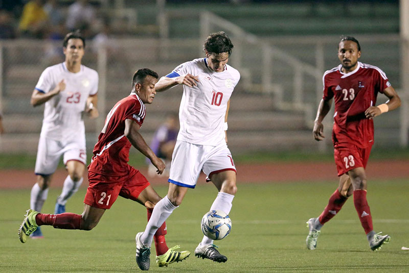 Phil Younghusband evades the defense of Bharat Khawas during the AFC Asian Cup Qualifiers Match at the Rizal Memorial Stadium.  KJ ROSALES