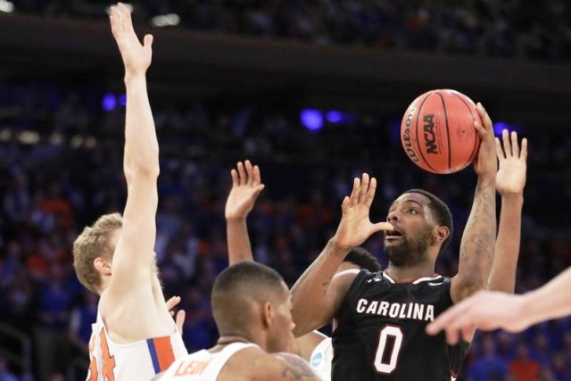 South Carolina guard Sindarius Thornwell (0) puts up a shot against Florida during the second half of the East Regional championship game of the NCAA men's college basketball tournament, Sunday, March 26, 2017, in New York. | AP Photo/Julio Cortez