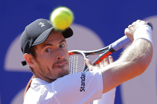 In this Friday, April 28, 2017 file photo, Andy Murray of Britain eyes the ball before playing a return shot to Albert Ramos-Vinolas of Spain during a quarterfinal match at the Barcelona Open Tennis Tournament in Barcelona, Spain. After months of disappointment and a lack of motivation, Andy Murray is counting on the French Open starting on Sunday May 28, 2017, to turn his season around. | AP Photo/Manu Fernandez, File