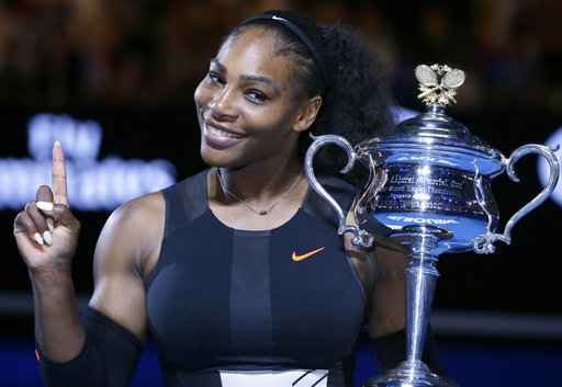 In this Jan. 28, 2017, file photo, Serena Williams holds up a finger and her trophy after defeating her sister, Venus, in the women's singles final at the Australian Open tennis championships in Melbourne, Australia. Williams wants to help diversify the tech industry now that she is joining a Silicon Valley boardroom for the first time. Online poll taking service SurveyMonkey announced Williams' appointment to its board on Wednesday, May 24, along with Intuit CEO Brad Smith. | AP Photo/Aaron Favila, File