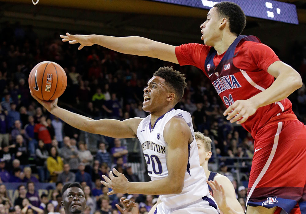 In this Feb. 18, 2017, file photo, Arizona's Chance Comanche, right, defends as Washington's Markelle Fultz's (20) looks for a shot during the second half of an NCAA college basketball game, in Seattle. Fultz is the likely No. 1 pick in the NBA Draft on Thursday night (Friday Manila time). | AP Photo/Elaine Thompson, File