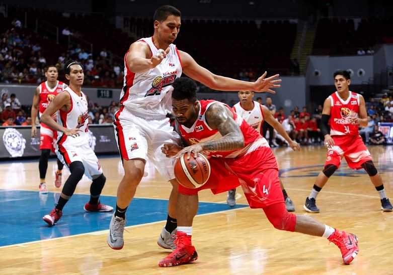 Phoenix import Eugene Phelps muscles his way to the basket against Alaska's Sonny Thoss in PBA's Saturday night action. | PBA Media