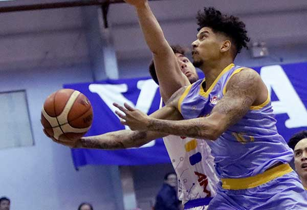 Marinerong Pilipino's Julian Sargent eludes AMA Online's Andrei Paras for a lay-up during their PBA D-League Foundation Cup encounter. PBA IMAGE