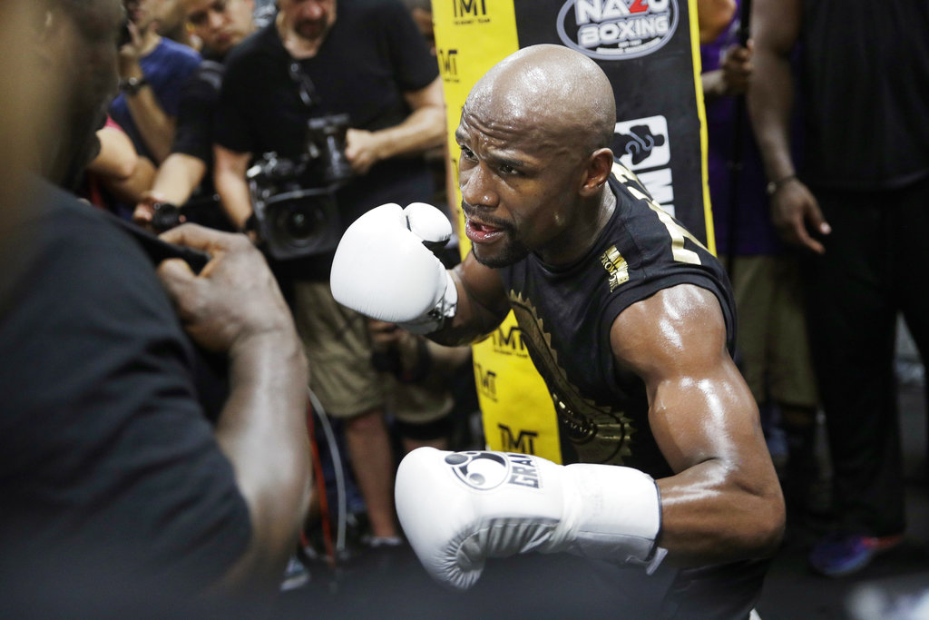 This Aug. 10, 2017, file photo shows Floyd Mayweather Jr. training at his gym in Las Vegas. Look at any boxing website, and the comments will largely all be the same. Mayweather Jr.'s fight with Conor McGregor is a joke, a spectacle that has little to do with real boxing. No reason to spend two cents on it, much less $100, when there's a real super fight coming up a few weeks later between Gennady Golovkin and Canelo Alvarez. | AP Photo/John Locher, File