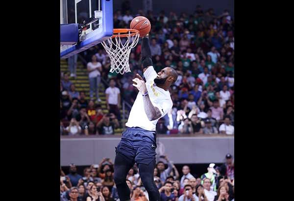 a701c17f052 LeBron James dunks in an exhibition game at the Mall of Asia Arena.