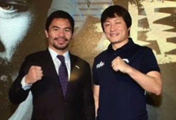 Sen. Manny Pacquiao is introduced to the Chinese market as an Anta endorser by Anta deputy chairman Ding Shijia.