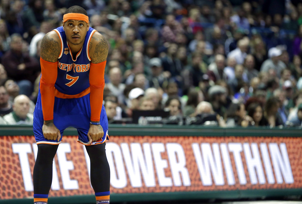 In this March 8 2017, file photo, New York Knicks' Carmelo Anthony watches a free throw during the second half of an NBA basketball game against the Milwaukee Bucks in Milwaukee. The Knicks agreed to trade Anthony to the Thunder on Saturday, Sept. 23, 2017, saving themselves a potentially awkward reunion next week with the player they'd been trying to deal since last season. New York will get Enes Kanter, Doug McDermott and a draft pick, a person with knowledge of the deal said. The person spoke with The Associated Press on condition of anonymity because the trade had not been announced. | AP Photo/Aaron Gash, File