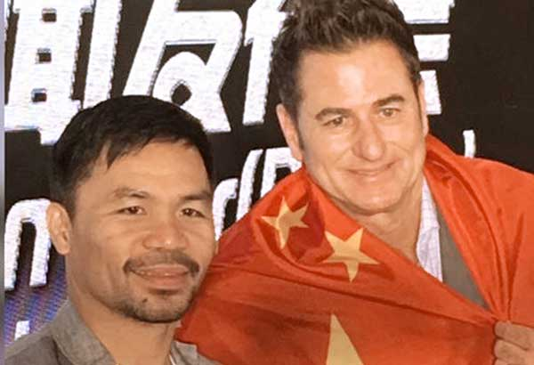 Sen. Manny Pacquiao and Sean Gibbons in Beijing.