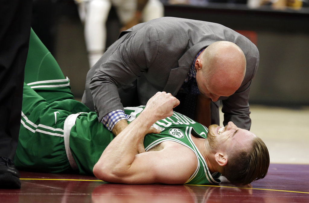Boston Celtics' Gordon Hayward grimaces in pain in the first half of an NBA basketball game against the Cleveland Cavaliers, Tuesday, Oct. 17, 2017, in Cleveland. Just five minutes into his Boston career, new Celtics star forward Gordon Hayward gruesomely broke his left ankle, an injury that may end his season. | AP Photo/Tony Dejak