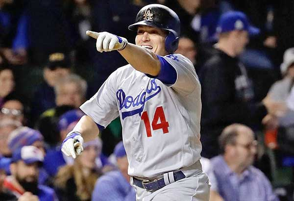 Enrique Hernandez of the Los Angeles Dodgers celebrates after hitting one of three home runs against the Chicago Cubs. AFP