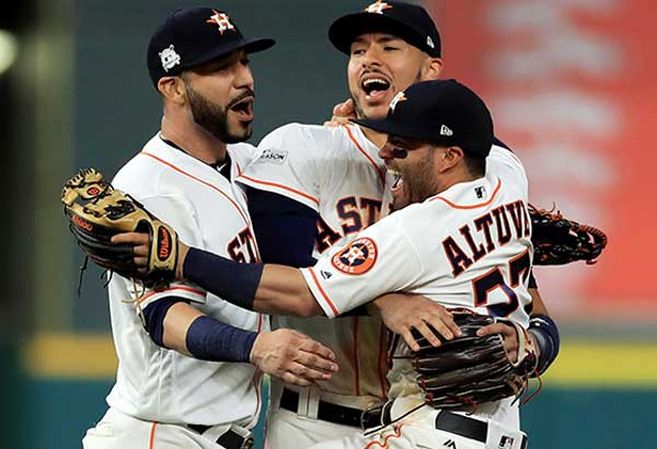 Marwin Gonzalez, Carlos Correa and Jose Altuve of the Houston Astros celebrate after defeating the New York Yankees in Game Seven of the American League Championship Series at Minute Maid Park in Houston, Texas. AFP