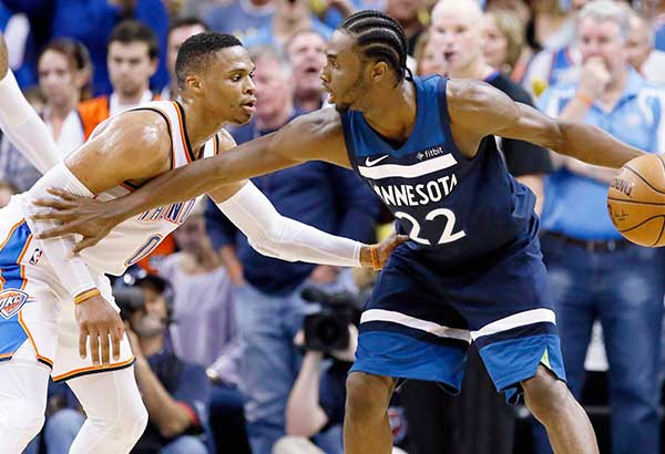 Minnesota Timberwolves' Andrew Wiggins (right) holds off Oklahoma's Russell Westbrook in the fourth quarter of their NBA clash in Oklahoma City. AP