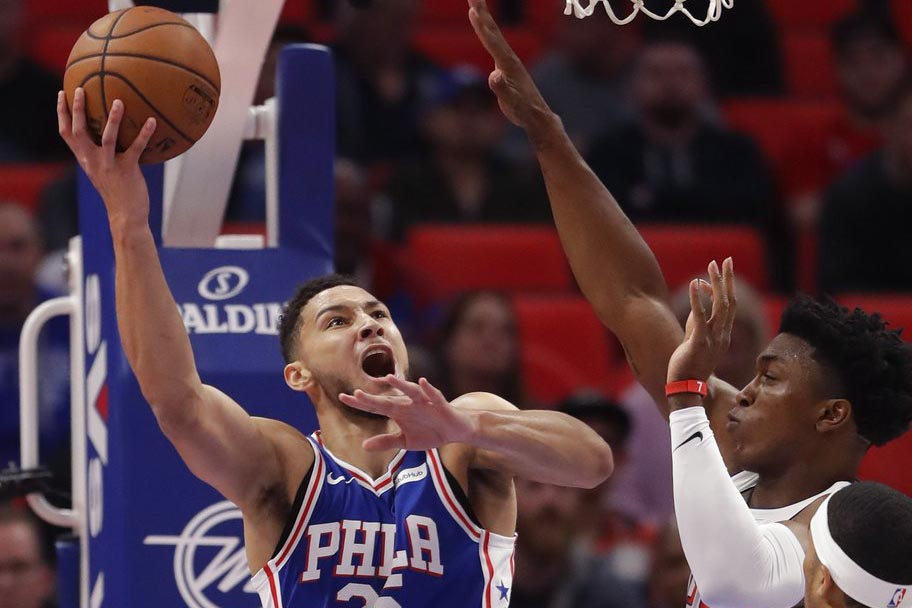 Philadelphia 76ers guard Ben Simmons (25) shoots as Detroit Pistons forward Stanley Johnson, right, defends during the first half of an NBA basketball game, Monday, Oct. 23, 2017, in Detroit. | AP Photo/Carlos Osorio