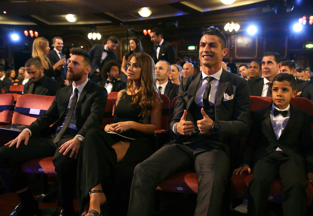 Portuguese soccer player Christiano Ronaldo, second from right, and son Cristiano Ronaldo Jr., right, sit beside Argentinian soccer player Lionel Messi, left, and wife Antonella during the The Best FIFA 2017 Awards at the Palladium Theatre in London, Monday, Oct. 23, 2017. | AP Photo/Alastair Grant