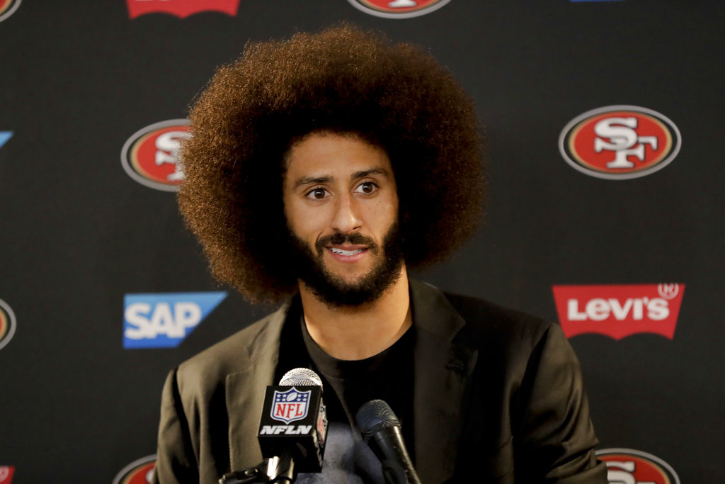 "In this Dec. 24, 2016, file photo San Francisco 49ers quarterback Colin Kaepernick talks during a news conference after an NFL football game against the Los Angeles Rams. The free agent quarterback was named GQ magazine's ""Citizen of the Year"" for his activism on Nov. 13, 2017. 