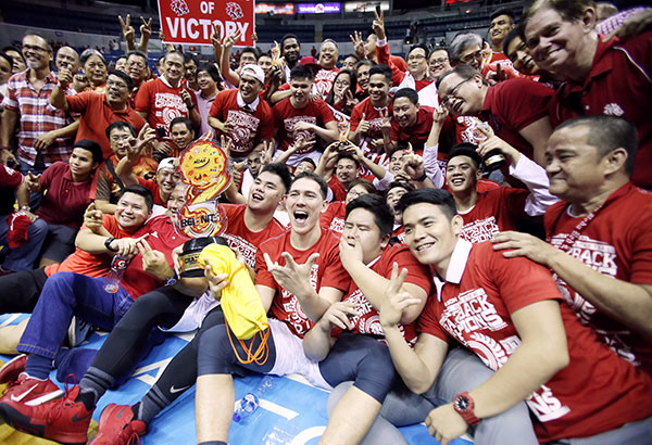 The San Beda Red Lions, led by coach Boyet Fernandez, celebrate with their supporters after repeating over the Lyceum Pirates to retain the NCAA crown. | Joey Mendoza