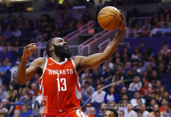 Houston Rockets guard James Harden (13) beats the Phoenix Suns defense, including guard Troy Daniels, right, to score during the first half of an NBA basketball game Thursday, Nov. 16, 2017, in Phoenix. | AP Photo/Ross D. Franklin