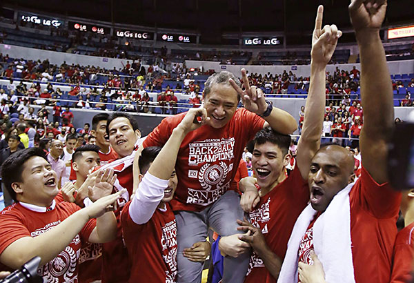 Red Lions coach Boyet Fernandez gets a victory lift after the Lions completed a sweep of the Lyceum Pirates to keep the NCAA cage crown Thursday at the Smart Araneta Coliseum. Joey Mendoza