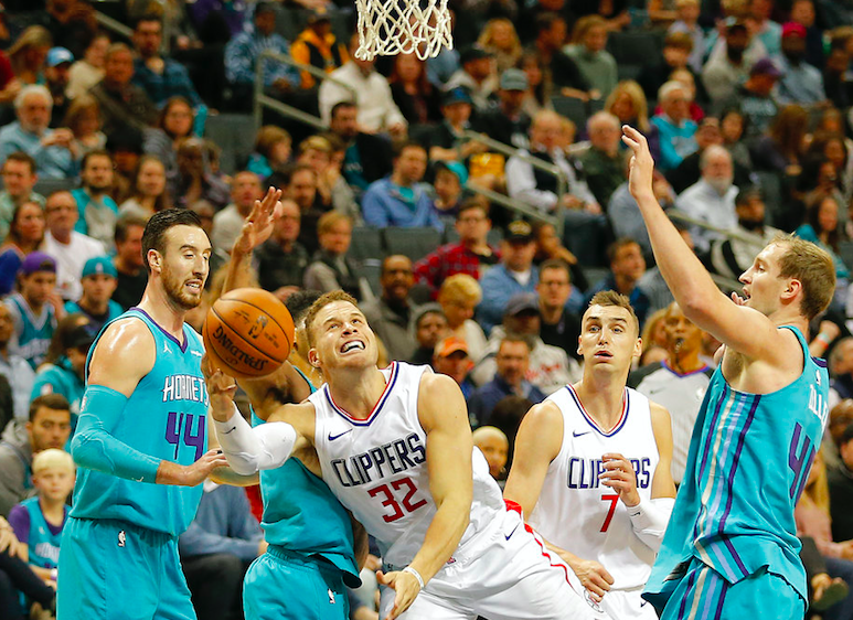 Los Angeles Clippers' Blake Griffin (32) tries to shoot as he stumbles to the basket by Charlotte Hornets' Frank Kaminsky, left, Jeremy Lamb, second from left, and Cody Zeller, right. as Clippers' Sam Dekker (7) looks on during the first half of an NBA basketball game in Charlotte, N.C., Saturday, Nov. 18, 2017 (Sunday in Manila). | AP Photo/Bob Leverone