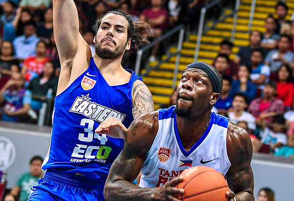 Christian Standhardinger (left) displays some of the stuff he would unload in the local pro league as he puts the pressure on Reggie Okosa during the Hong Kong Eastern-Alab Pilipinas match in the opener of the ASEAN Basketball League at the MOA Arena Sunday. Photo courtesy aseanbasketballleague.com