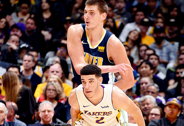 Lonzo Ball of the Los Angeles Lakers boxes out Nikola Jokić of the Denver Nuggets during their NBA game at Staples Center in Los Angeles, California. AFP