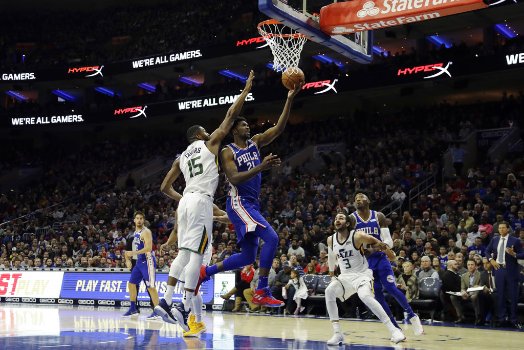 Philadelphia 76ers' Joel Embiid (21) goes up for a shot against Utah Jazz's Derrick Favors (15) during the first half of an NBA basketball game, Monday, Nov. 20, 2017, in Philadelphia. | AP Photo/Matt Slocum
