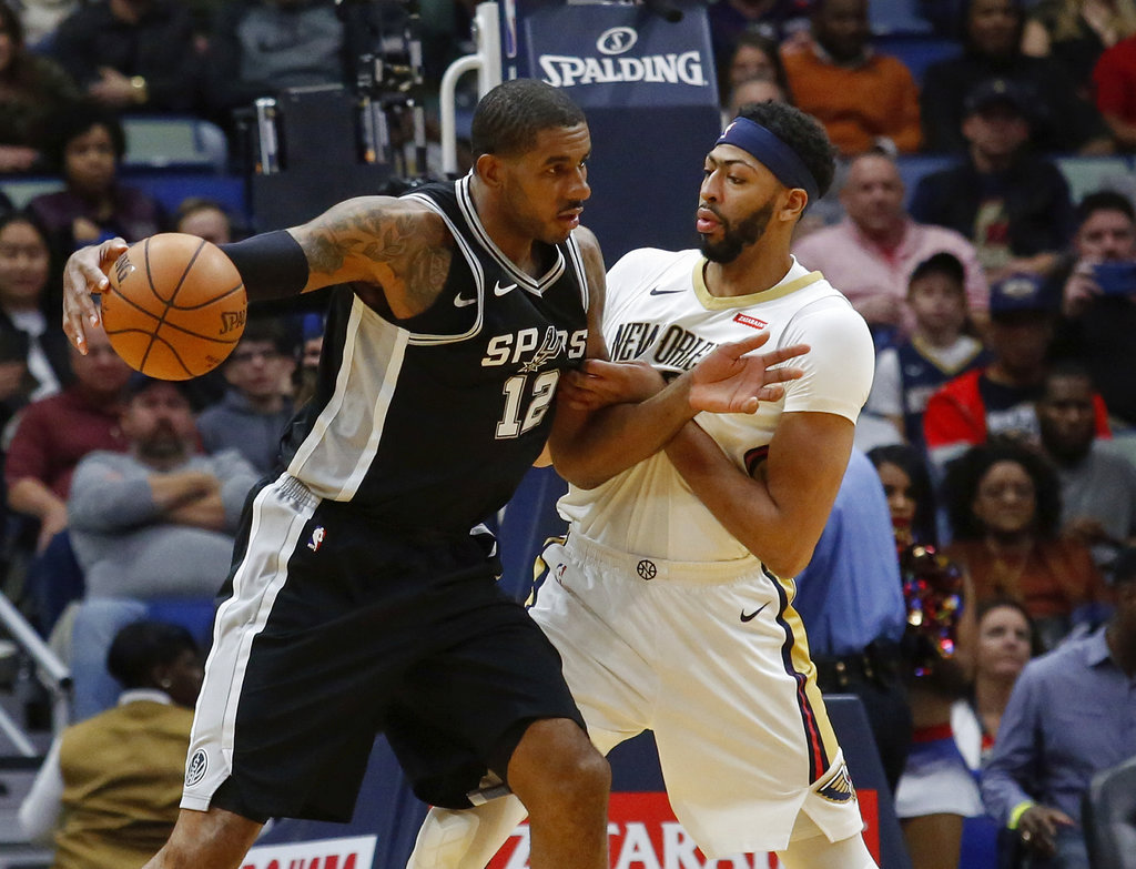 San Antonio Spurs forward LaMarcus Aldridge (12) works against New Orleans Pelicans forward Anthony Davis (23) in the first half of an NBA basketball game in New Orleans, Wednesday, Nov. 22, 2017. | AP Photo/Scott Threlkeld