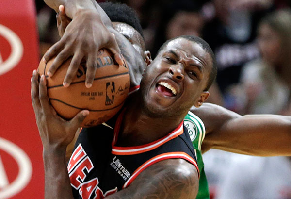 Miami Heat's Dion Waiters fights for the ball with Boston Celtics' Jaylen Brown during the first half of an NBA game in Miami. AP