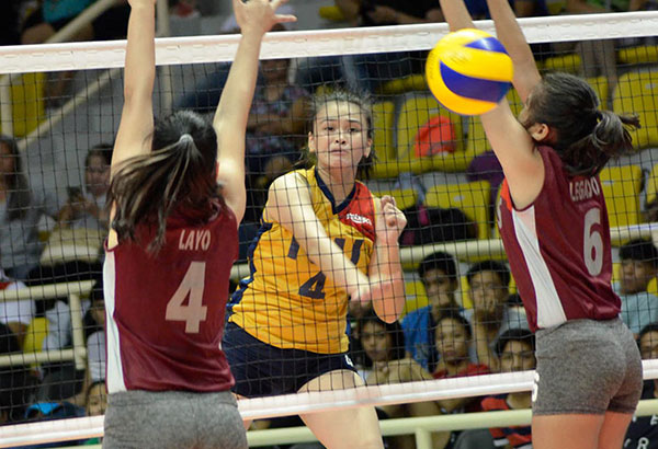 Nazareth School of National U top hitter Michaela Belen hammers in a kill against Chariz Layo and Bea Legado during their Rebisco Volleyball League clash at the Sta. Rosa Multi-Purpose Sports Complex in Laguna Thursday.