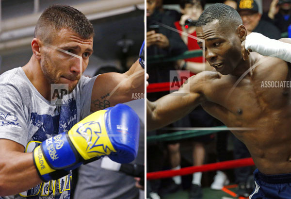 Left: Vasyl Lomachenko, of Ukraine, punches a bag during a workout at a Manhattan boxing gym Wednesday, Dec. 6, 2017, in New York; right: Guillermo Rigondeaux, of Cuba, works out with his trainer at a Manhattan gym in preparation for his WBO super featherweight title fight against titleholder Lomachenko. | AP photos/Kathy Willens