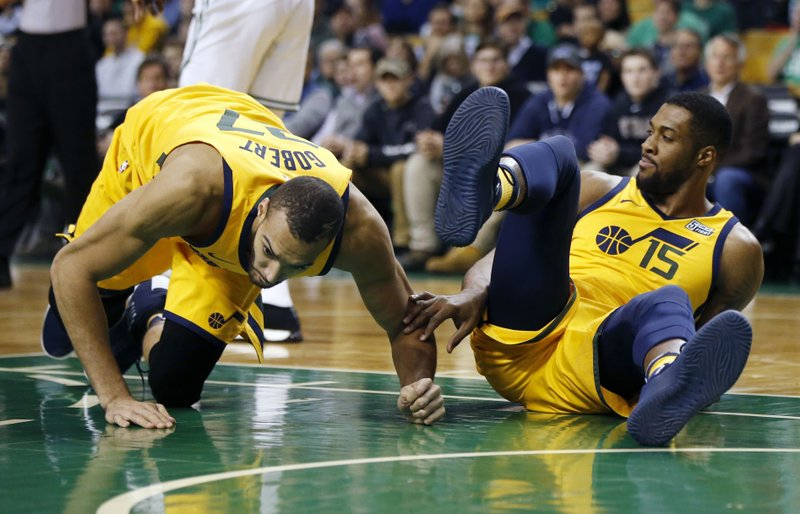 Jazz center reportedly to miss month with sprained knee
