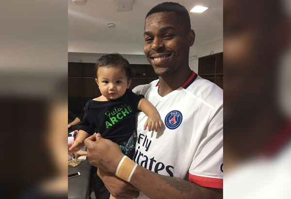 Ben Mbala with 11-month-old fan Jose Ngkaion.
