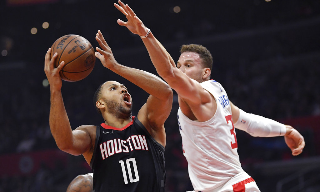 Houston Rockets guard Eric Gordon, left, shoots as Los Angeles Clippers forward Blake Griffin defends during the first half of an NBA basketball game, Monday, Jan. 15, 2018, in Los Angeles. | AP Photo/Mark J. Terrill