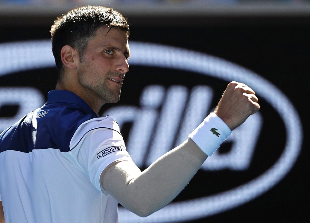 Serbia's Novak Djokovic celebrates after defeating United States' Donald Young during their first round match at the Australian Open tennis championships in Melbourne, Australia, Tuesday, Jan. 16, 2018. | AP Photo/Dita Alangkara