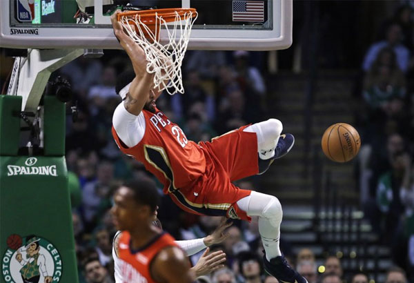 New Orleans Pelicans forward Anthony Davis slams a dunk during the first quarter of an NBA basketball game against the Boston Celtics in Boston, Tuesday, Jan. 16, 2018. | AP Photo/Charles Krupa